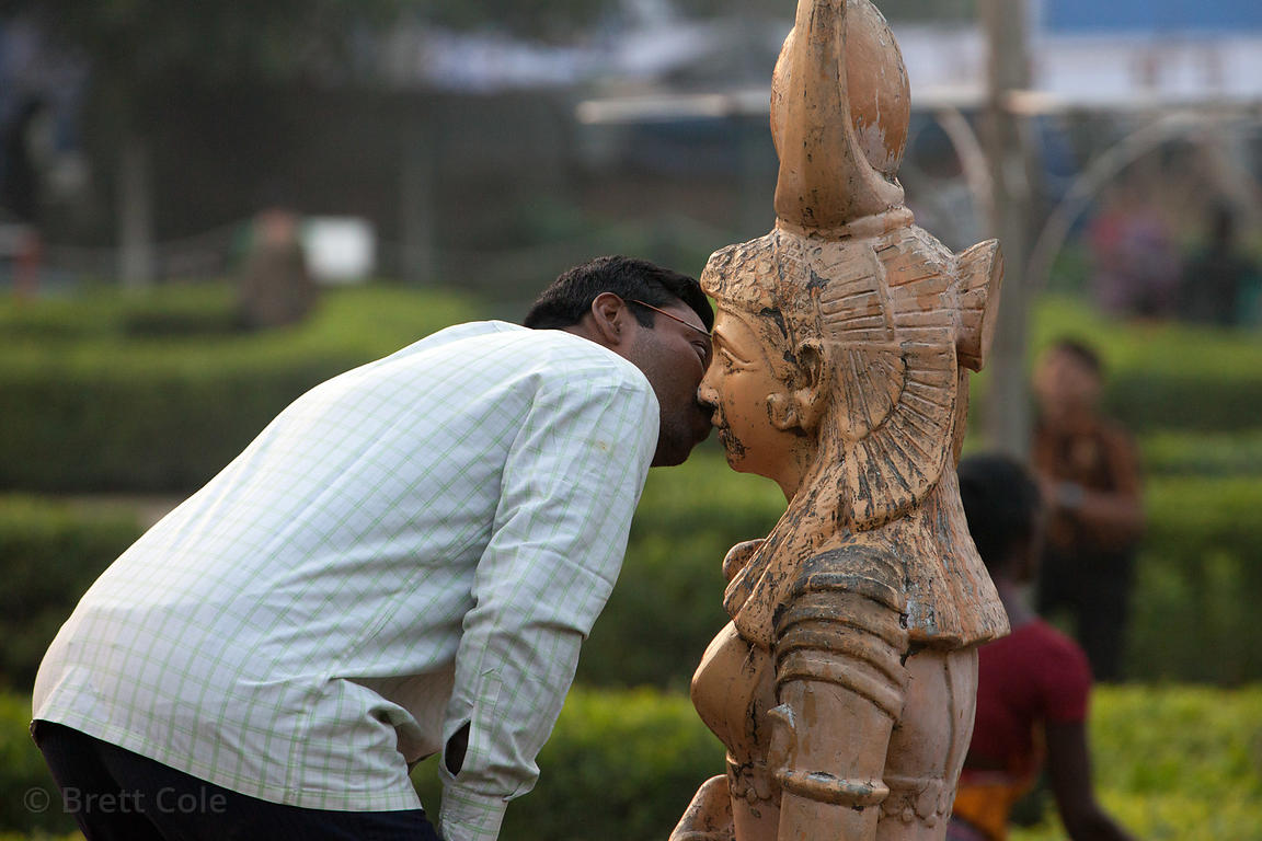 A man kisses a statue at Science City, Kolkata, India.