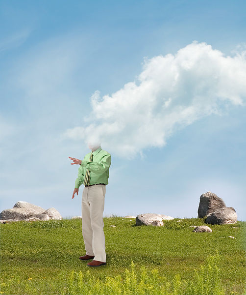 man in field overcome by cloud