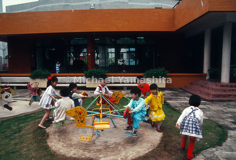 Children play during recess in Kindergarten. Shekou, China.