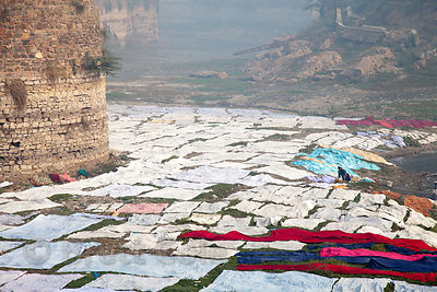 A huge laundry operation in the 100 foot deep dry moat of Lohagarh Fort, Rajasthan, India