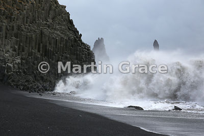 Reynisfjara beach of black volcanic sand, near Vik on Iceland's south coast