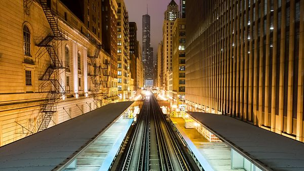 Wide Shot: Commuter Trains Inside High-rise Canyons With Trump Tower in the Distance