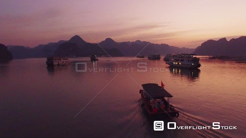 Sunset Over a Small Boat in Ha Long Bay Vietnam