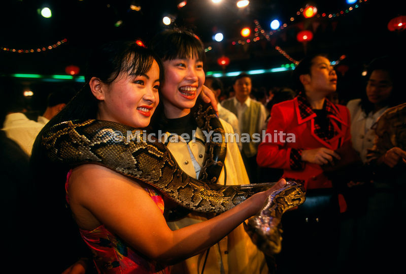Flying Dragon Amusement Park promotes love of snakes - sells snake products - food, medicine, clothes, etc..Panyu, China