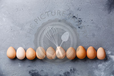 Guinea-fowl eggs on concrete background copy space
