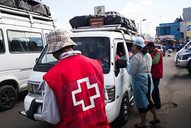 "Doctors and nurses from The Ministry of Health and officers of the Malagasy Red Cross staff a healthcare checkpoint at the ""t..."