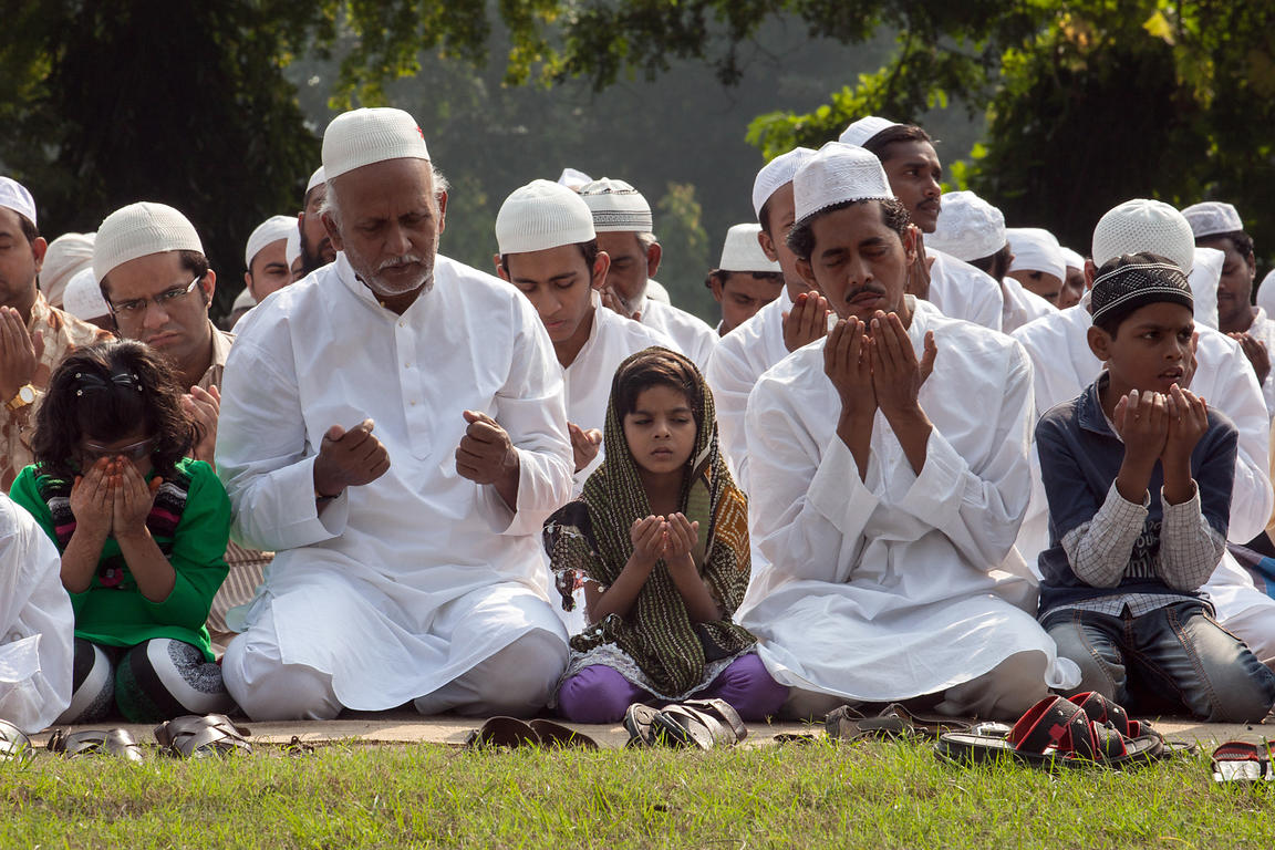 Muslims pray during Eid al-Adha on Red Road in Kolkata, India. Eid al-Adha is the most important Muslim holiday, and Red Road...