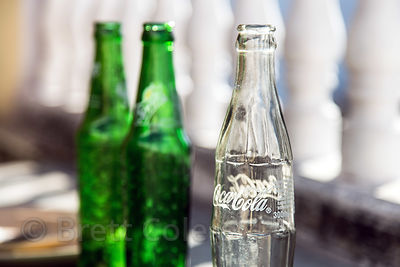 Glass Coke bottle at a restaurant, Pushkar, Rajasthan, India. Such bottles are washed and re-filled in India.