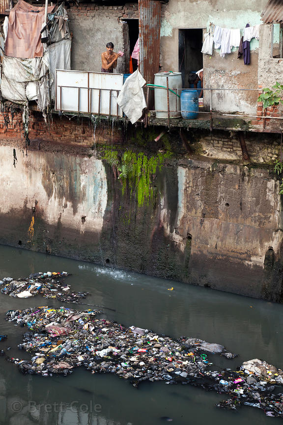 Foul water in the Dharavi slum, Mumbai, India. Toilets open directly to the canals in some parts of Dharavi.