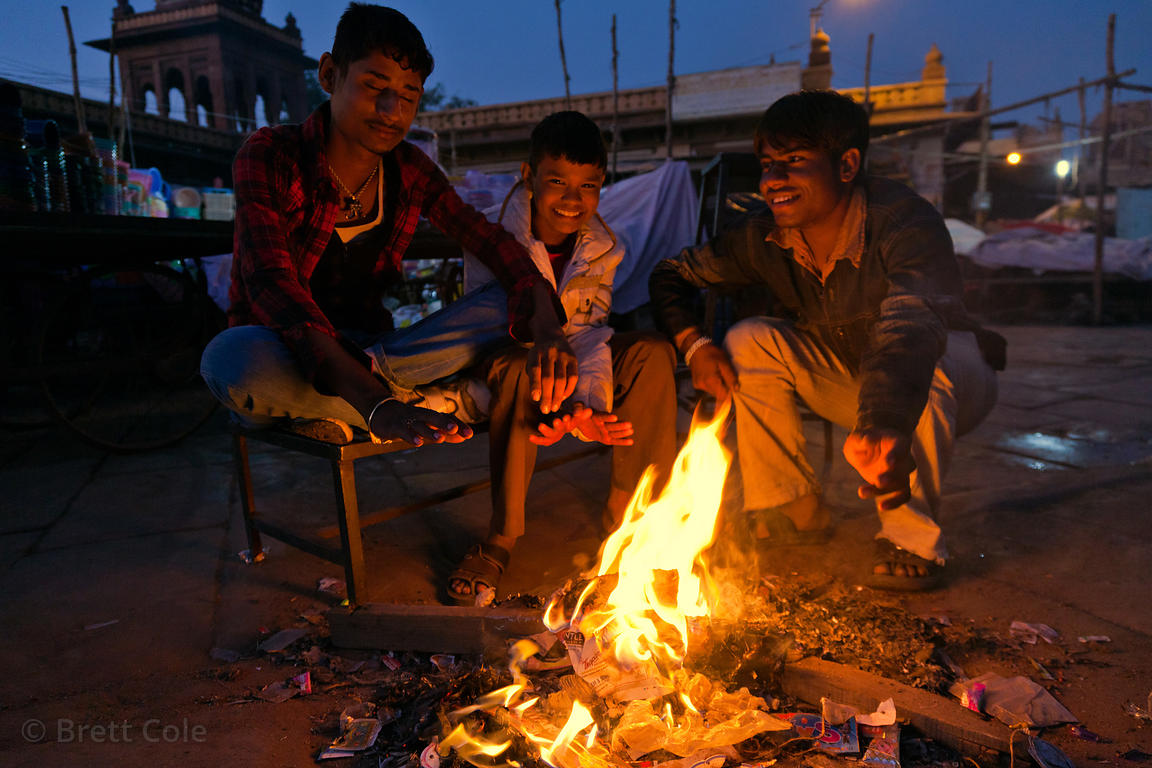 Fighting off the early morning cold by a fire in the streets, Jodhpur, Rajasthan, India