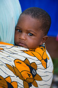 Baby on its mothers back, Tendaba village, the Gambia