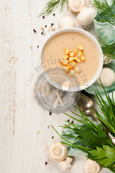 Creamy Mushroom Soup on white rustic background