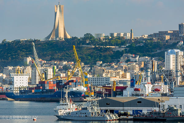 View across the port of Algiers with the Martyrs monument on the hill above the city, Algeria, North Africa