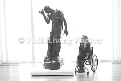 Woman using a wheelchair visiting the Raleigh Museum of Art