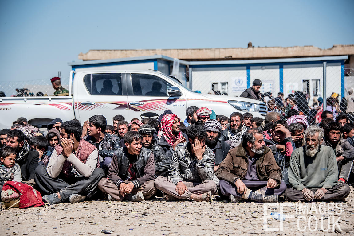 Men Sitting Waiting To Go Through A Security Check To See Whether Or Not They Are Members Of ISIS. At Hamam al Alil IDP Camp,...