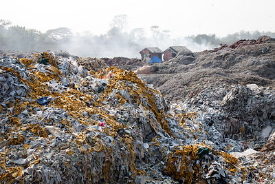 Scrap leather waiting to be burned in furnaces in the East Kolkata Wetlands, near the rural town of Bantala, Kolkata, India.