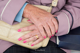 Old lady's hands with pink nail.