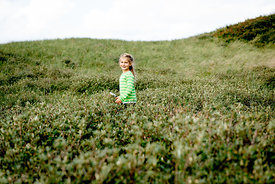 Girl with magnifying glass in Danish dunes 3