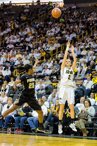 Iowa's Aly Disterhoft (2) fires a three-point shot as Purdue's April Wilson (25) defends during the first half of play at Car...