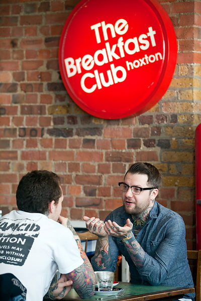 UK - London - Two men sit and talk in the Breakfast club, a lounge and diner off Hoxton Square