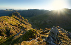 Sunrise over Ennerdale Water from Scoat Fell with views of Steeple and Pillar In the English Lake District, UK.