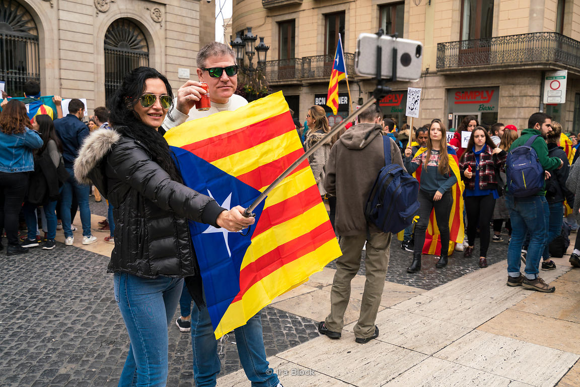 Tourists take selfies at Plaça Sant Jaume in Barcelona, Spain amidst a strike protesting the jailing of Catalonia officials.