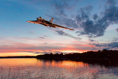 Vulcan low over a sunset lake