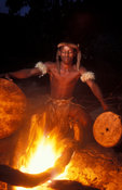 Zulu warrior heating the drums before playing, Kwazulu-Natal, South Africa