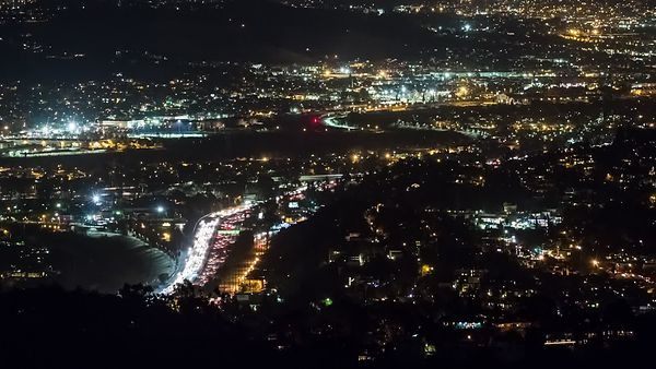 Bird's Eye: A Busy Freeway of Light Cutting Through Darkness