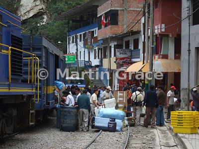 Unloading freight from a railway wagon, Aguas Calientes, Peru