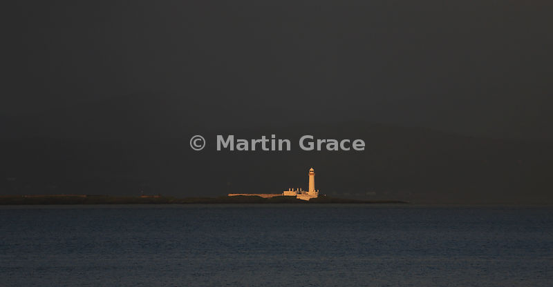 Lismore Lighthouse in the last rays of the setting sun, Eilean Musdile off Lismore Island, Firth of Lorne, Argyll & Bute, Sco...