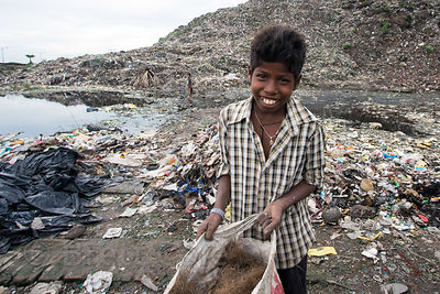 Boys haul reclaimed plastic down from the top of the Dhapa dumping ground (landfill) to take it to nearby processing faciliti...