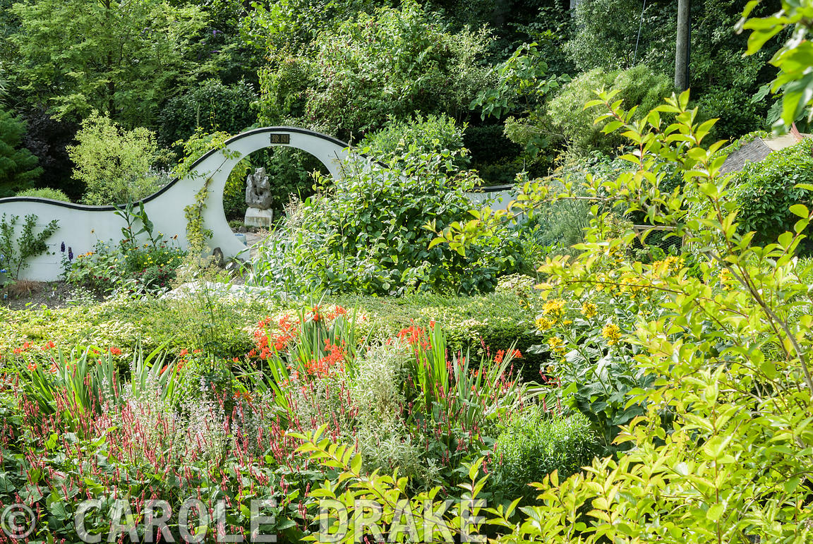 View from Wildly-Cheering Pavilion giving views over the herbaceous border and into the kitchen garden backed by undulating w...