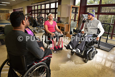 Group of adults in a rehabilitation gym