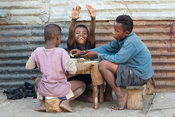 Children playing dominos, street scene, Toliara, Madagascar