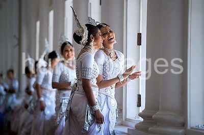 Two Women in Traditional Kandyan Dress Laugh While Waiting as Secretary Kerry Meets With Sri Lankan Foreign Minister Samaraweera