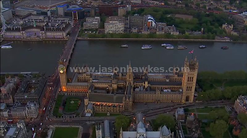 Aerial footage of The Houses of Parliament at night, Westminster, London, England, UK