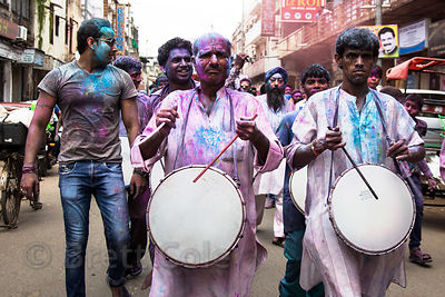 Men covered in gulal powder march and play drums during the Ganesh Chaturthi festival in Delhi, India