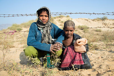 Girls from a low income family in a remote part of the Pushkar desert, Kishanpura Goyla village, Rajasthan, India
