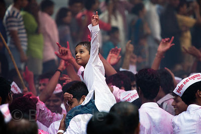 A boy cheers in a crowd at the Ganesh Chaturthi festival in Lalbaug, Mumbai, India.