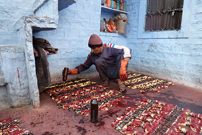 A man with 30 years experience tie-dyes fabrics on the roof of his house in Jodhpur, Rajasthan, India