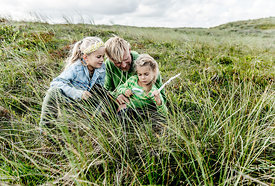 Danish father and daughters playing in the dunes in Thy 2