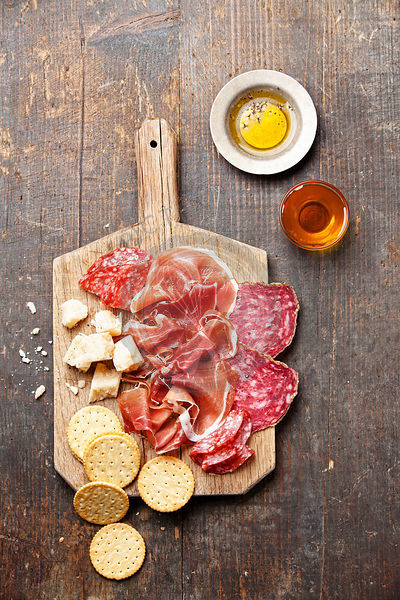 Chopping board of Assorted Cured Meats, Cheese and Honey