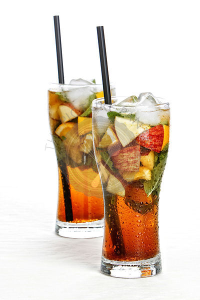 Two glass of iced tea on white background