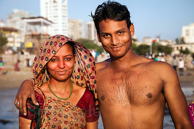 People celebrate the Ganesh Chaturthi festival on Chowpatty Beach, Mumbai, India.