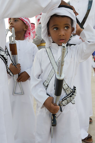 Omani boys with toy guns, Sharjah Heritage Days cultural festival, Heritage Area, Sharjah, Emirates