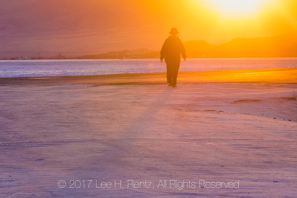 Woman Walking at Sunset on the Bonneville Salt Flats