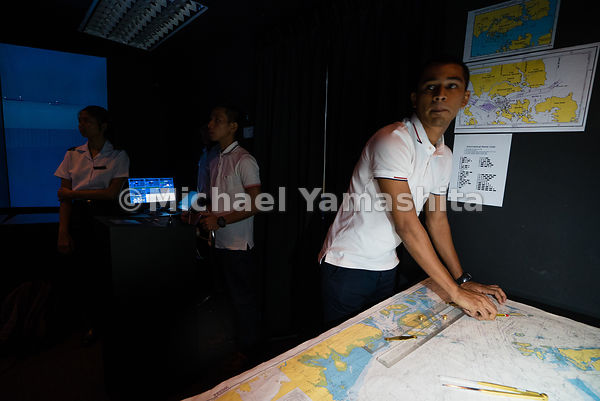 A future maritime officer keeps his eyes peeled to the screen. Spread out across a large table, printed nautical charts allow...