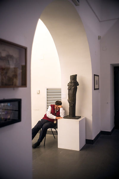 An attendant falls asleep in the Museum of contemporary art in The Castel Nuovo