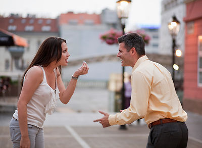 Croatia, Zagreb, Woman and man arguing on street